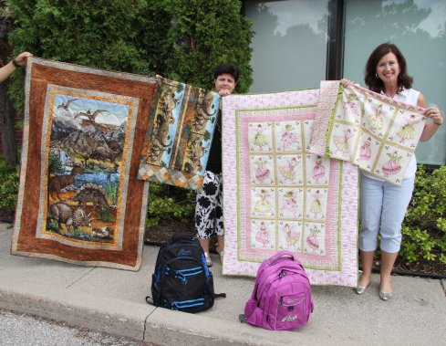 Susanne and I with our pillowcases, cuddle quilts and backpacks of school supplies