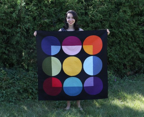 A jubilant Ghazal with her Transparency quilt