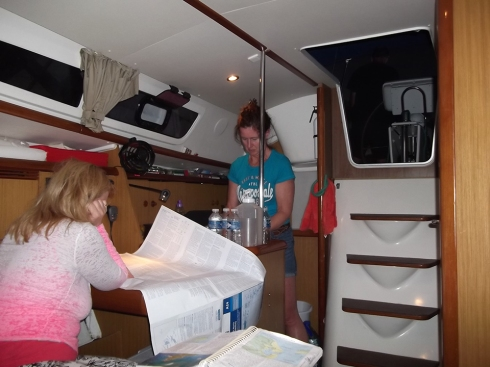 Jennifer works on navigation while I prepare dinner in the galley.