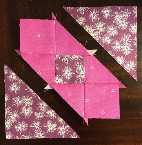 I sewed the 3 rows together and finger-pressed toward Rows 1 & 3. Leave the triangle tips on!