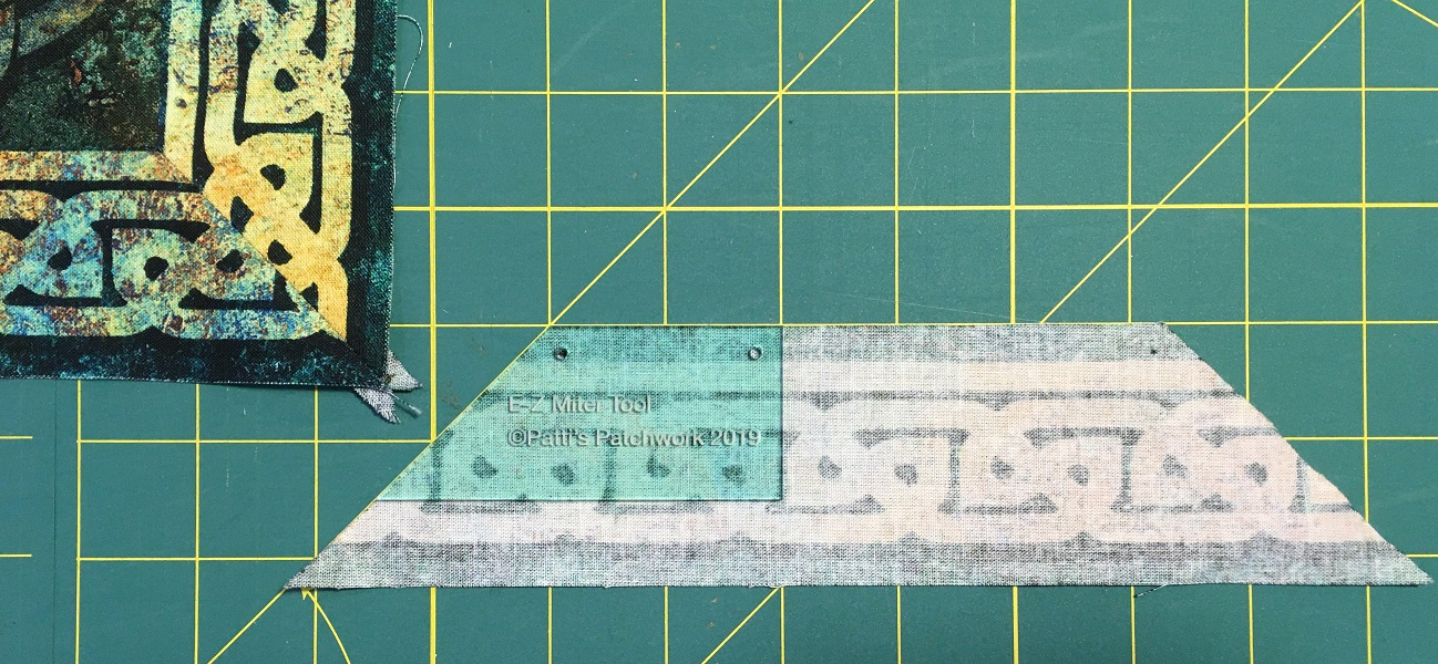 The E-Z Miter/Lone Star tool for easy mitered borders every time - no kidding!