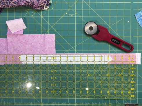 I taped my cutting template to the underside of my ruler