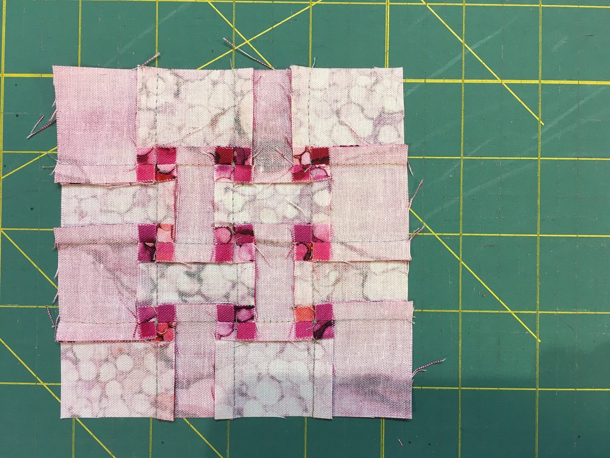 I spun the seams to reduce the bulk and allow the block to lay flat