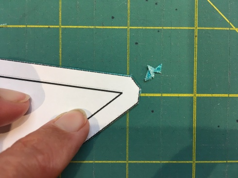 Trim the tips of the patches along blunted ends of templates