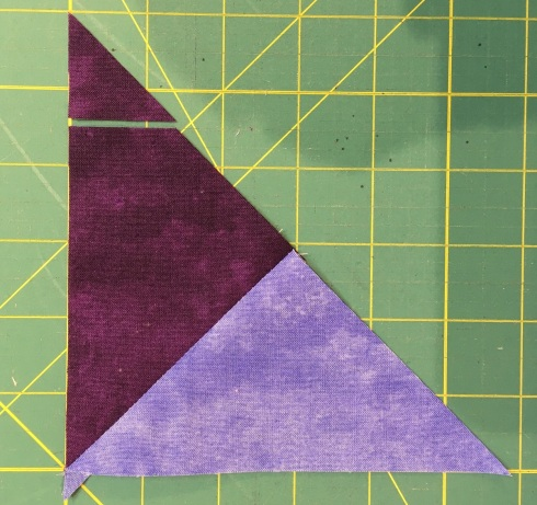 Trim the tip of the triangle pair to bring it to size
